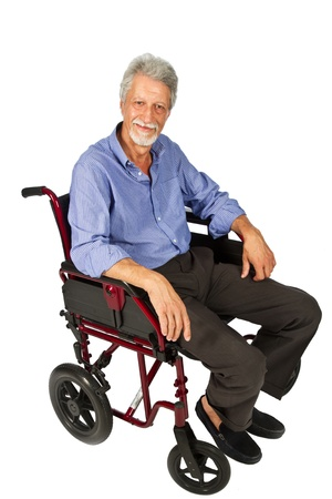 Smiling aged man patient in a wheelchair  photo