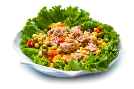 mais: tuna salad with mais on white shell dish isolated on white
