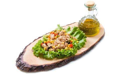 mais: tuna salad with mais  on wood board isolated on white