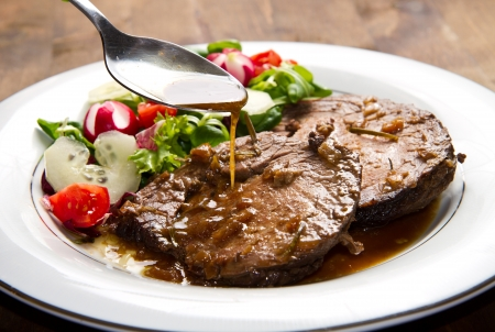 beef  garnished with fresh salad,  tomatoes, raddishes and cucumbers Stock Photo - 21378481