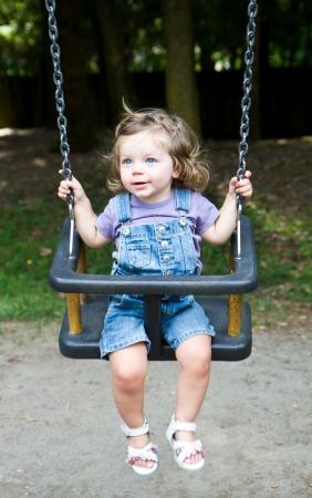 happy little girls  on a swing  photo
