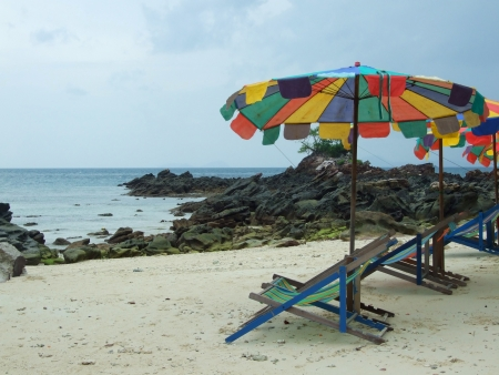 Tropical beach scenery with parasols in Thailand  photo