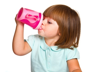 softness: Portrait of a cute drinking little toddler girl  Stock Photo