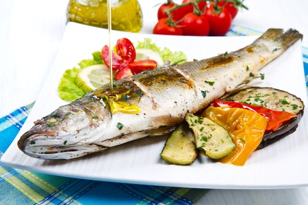 sea bass: fish, sea bass grilled with lemon and grilled vegetables Stock Photo