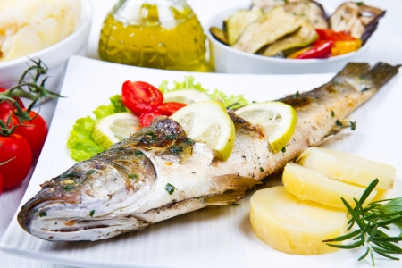 grilled fish: fish, sea bass grilled with lemon ,salad and potatoes