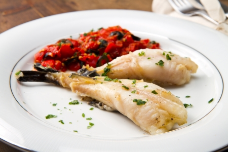 cod oil: delicious monkfish with tomatoes sauce, olive and capers