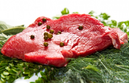 a red meat with sage and rosemary isolated on white background Stock Photo - 21917964