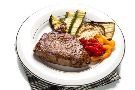seared: Delicious beef steaks on white dish with grilled vegetables