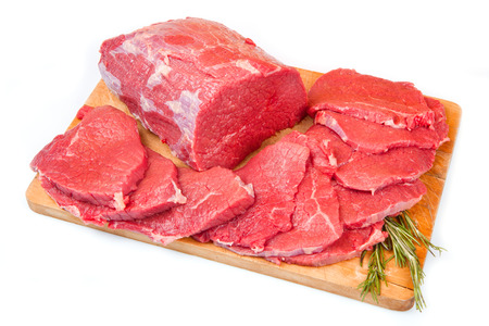 huge red meat chunk and steak on wood table photo