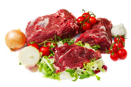 butchered: huge red meat chunk with vegetables