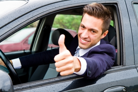 man thumbs up: Happy man in his new car