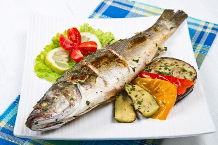 fish, sea bass grilled with lemon and grilled vegetables photo