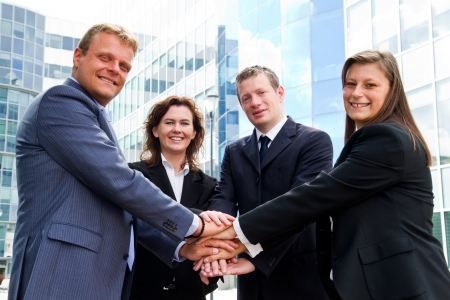 Business people joining hands photo