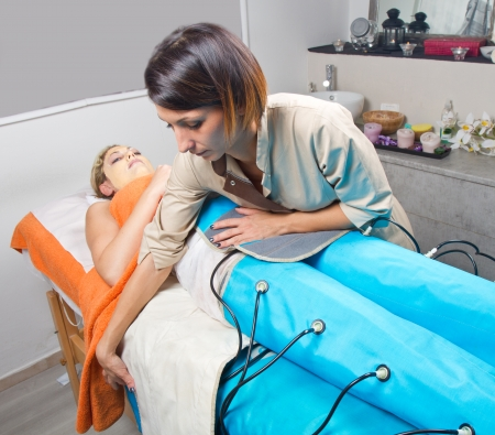 legs pressotherapy machine on woman in beauty center Stock Photo - 23568860