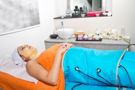 legs pressotherapy machine on woman in beauty center Stock Photo - 23568861