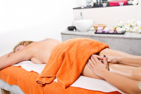Relaxed woman having a massage in a beauty center Stock Photo - 23568864