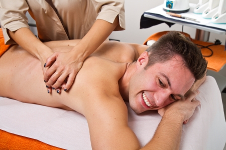 attractive man having a back massage in a beauty center Stock Photo - 23568907