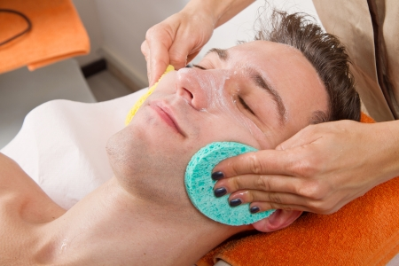 Female hands cleaning man's face  in a spa center Stock Photo - 23568913
