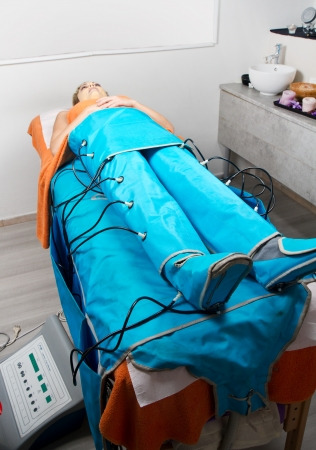 legs pressotherapy machine on woman in beauty center Stock Photo - 23568924