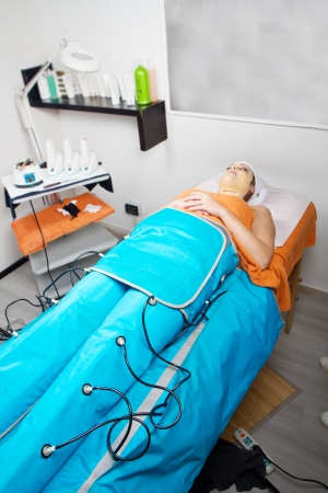 legs pressotherapy machine on woman in beauty center photo