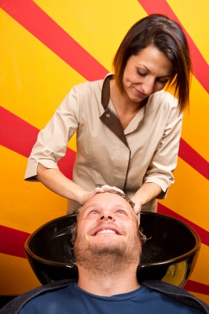 Washing man hair in beauty parlour hairdressing salon  Stock Photo - 23568946