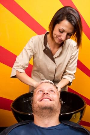 parlour: Washing man hair in beauty parlour hairdressing salon