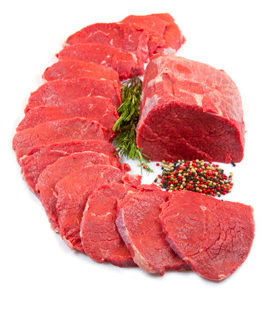 huge red meat chunk and steak isolated over white background  photo