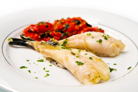 bass fish: delicious monkfish with tomatoes sauce, olive and capers