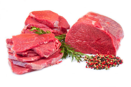 huge red meat chunk and steak isolated over white background  Stock Photo