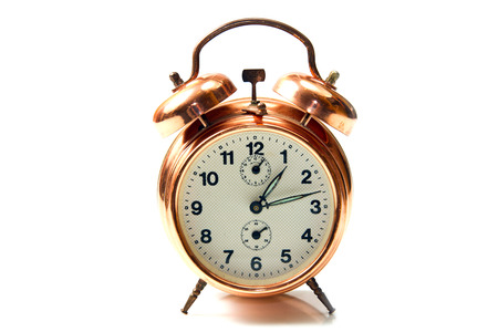 old style alarm clock isolated on white  photo