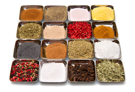 colored and mixed spice in box on white background photo