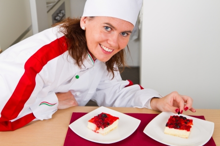 beautiful young chef decorating delicious dessert  photo