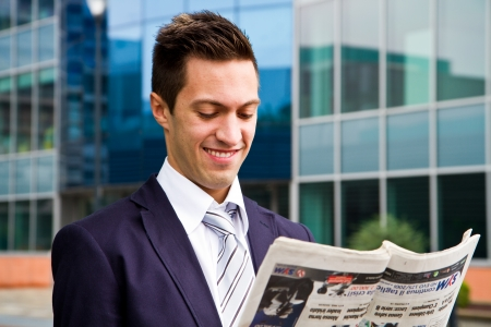 young businessman read a newspaper photo