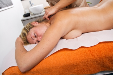 Relaxed woman having a massage in a beauty center Stock Photo - 24137521