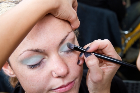 Make-up artist  applying eyebrow make-up Stock Photo - 24140122