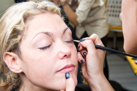 Make-up artist  applying eyebrow make-up Stock Photo - 24140123