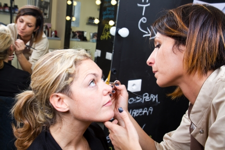 Make-up artist  applying eyebrow make-up Stock Photo - 24140140