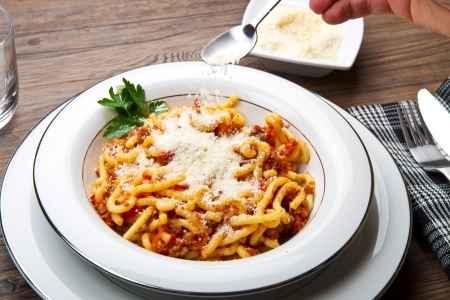 pasta with bolognaise sauce and herbs  photo