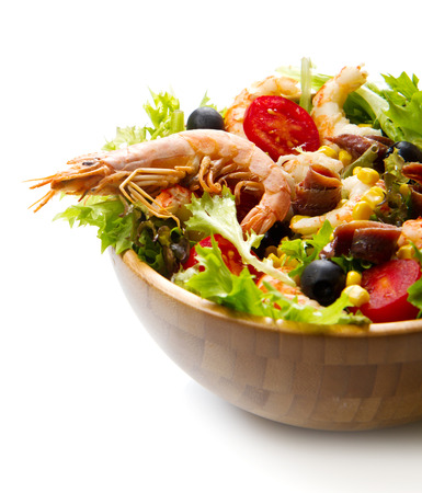 salad greens:  salad of shrimp, mixed greens, black olives anchovies and tomatoes isolated on white Stock Photo