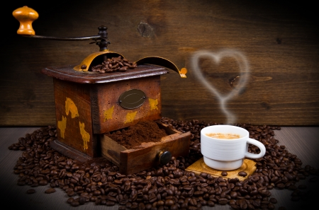 Coffee Grinder with Beans and coffe cup photo