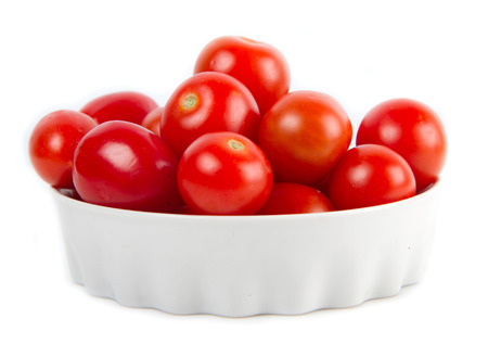 bowl with fresh tomatoes  photo
