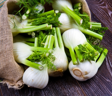 Fresh fennel on wooden background