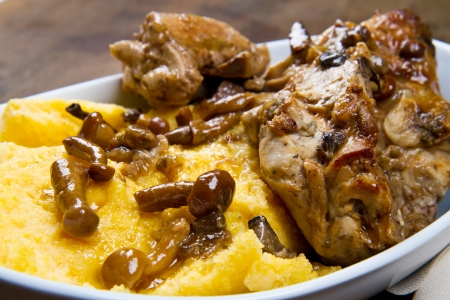 rabbit with mushrooms and polenta Standard-Bild