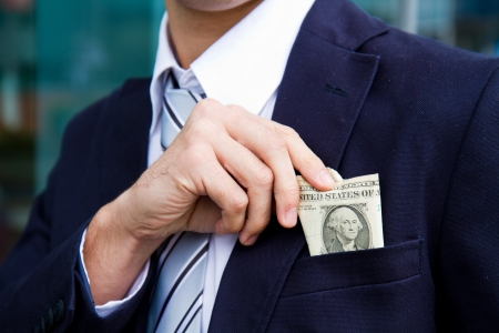 businessman outside office taking banknotes photo