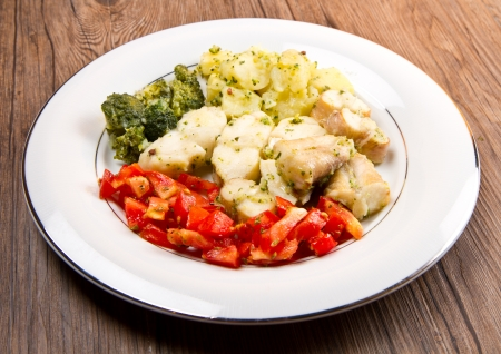 tasty healthy monkfish  with vegetables photo