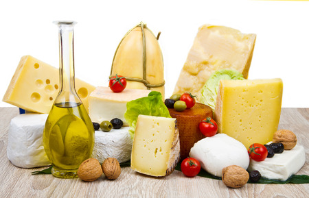 scamorza cheese: Various types of cheese on white wood Stock Photo