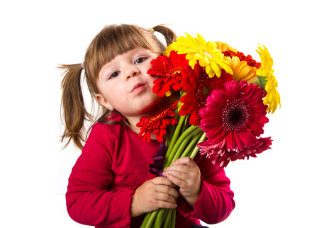 Cute little girl with gerbera flowers bouquet photo