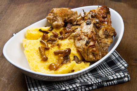 red braised: rabbit with mushrooms and polenta Stock Photo