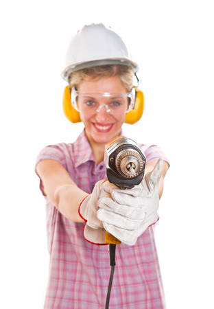 woman carpenter holding drill  photo