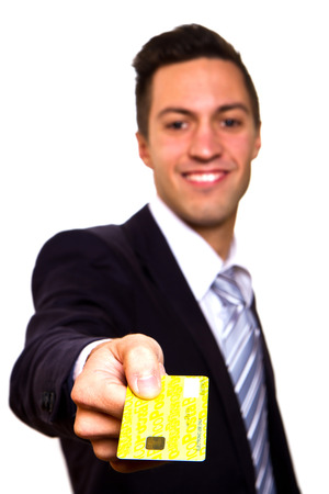 costumer: Happy smiling young man holding a credit card isolated on white background